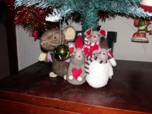 Four stuffed toy mice under a Christmas Tree